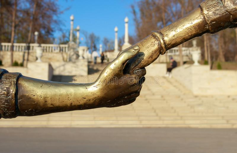 Statue with a boy and a girl holding her hand royalty free stock images