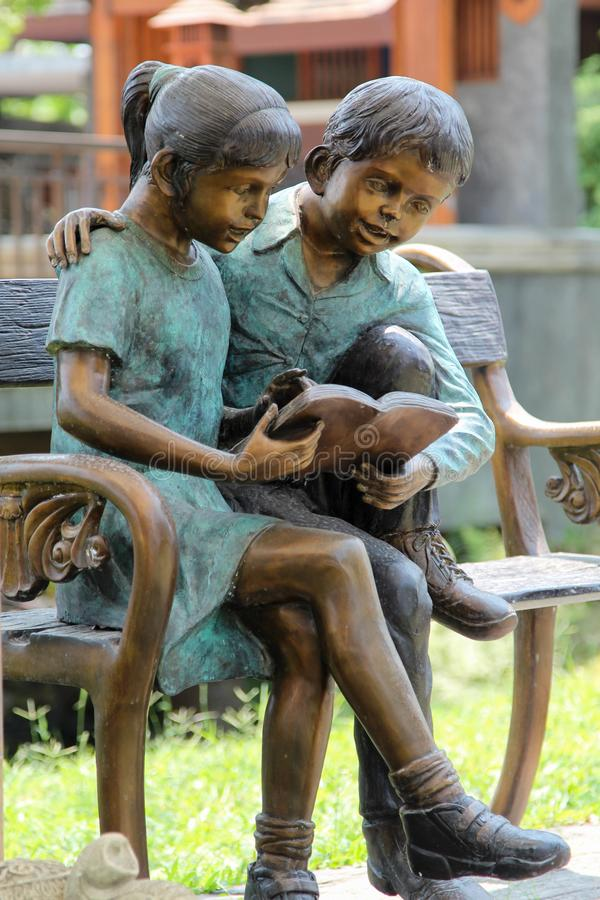 Statue Of Boy Reading On Bench Stock Photo Image Of