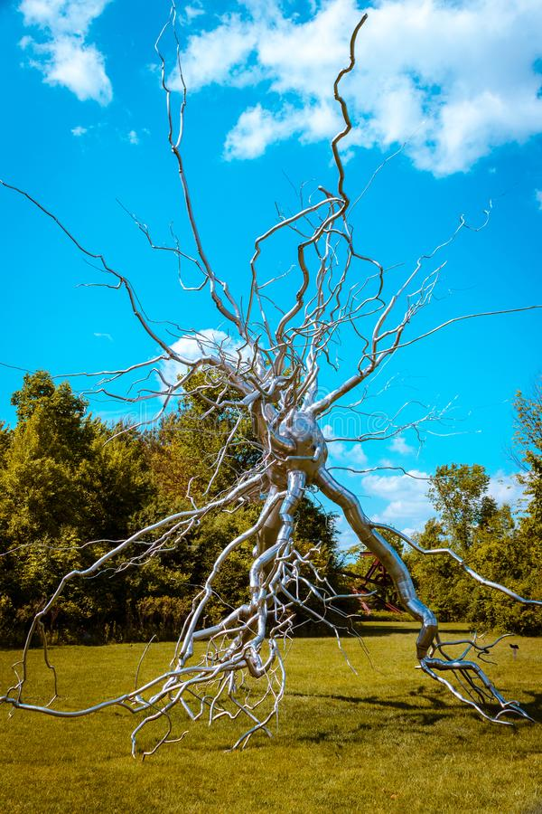 Statue of a brain synapse on display at the Frederik Meijer Gardens in Grand Rapids Michigan. On a sunny day stock photo