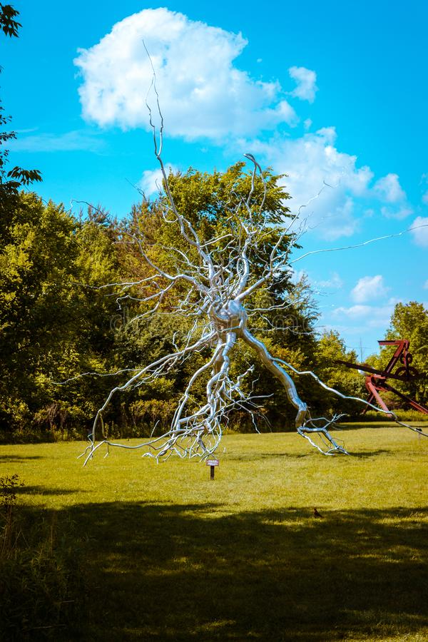 Statue of a brain synapse at the Frederik Meijer Gardens. On a sunny day stock photos