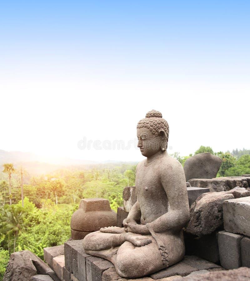 Statue of Buddha, Borobudur Buddhist Temple, Java Island, Indonesia. Ancient statue of a meditating Buddha in Borobudur Buddhist Temple, Java Island, Indonesia royalty free stock image