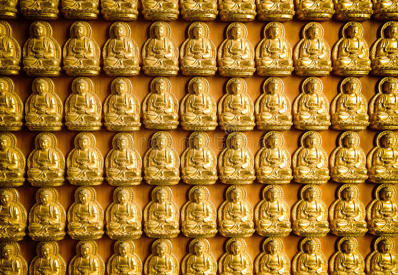 The statue of Buddha in Chinese temple wall stock image
