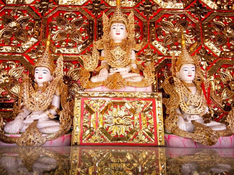 Statue, Buddha image, gold ornaments, Burmese traditional art, royalty free stock image