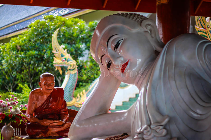 Statue of Buddha and Monk royalty free stock images