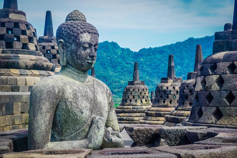 The statue of Buddha on one of the ancient temples of the World - the temple of Borobudur. Indonesia stock image