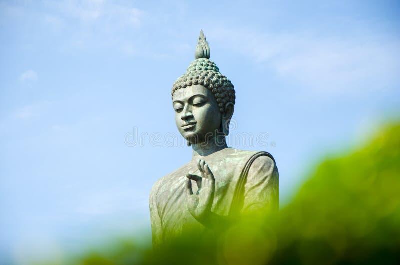 Statue of Buddha at peace stock photo