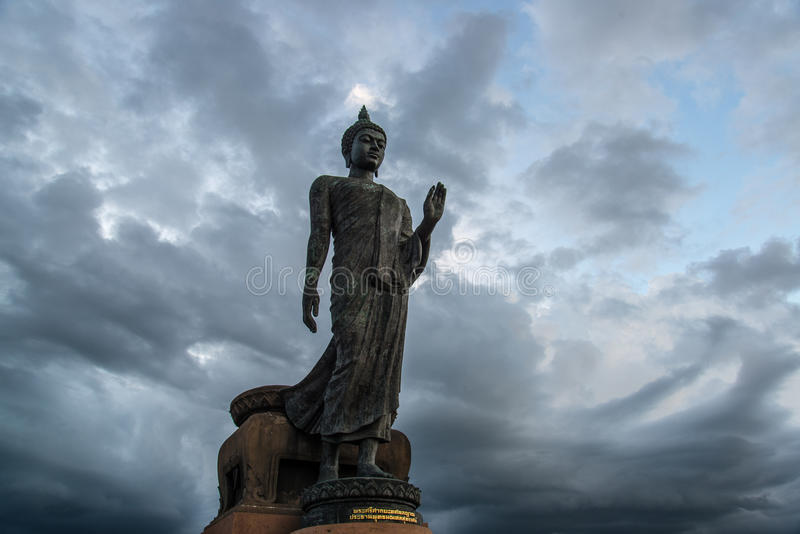 Statue of Buddha. With rain clouds stock image