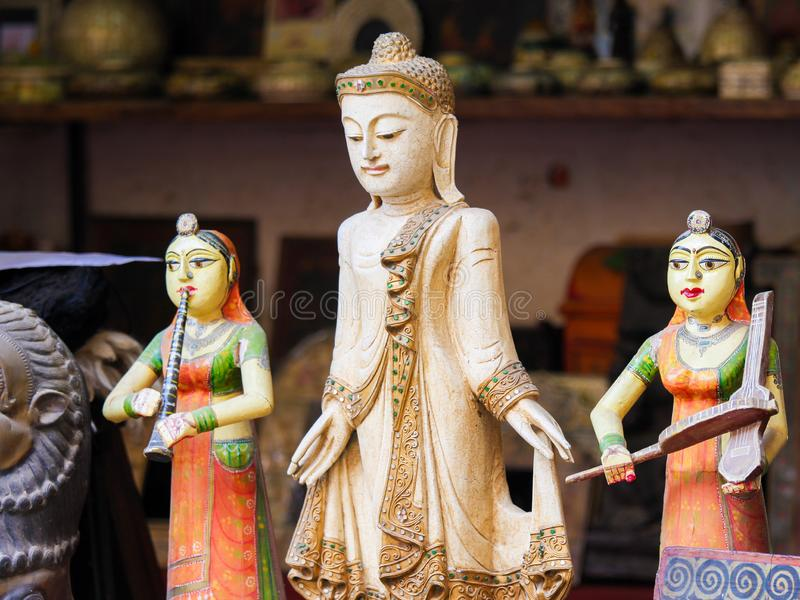 Jaisalmer, India - Statues of Buddha and Indian Women. Statue of Buddha and two Indian Women on a souvenir market in Jaisalmer Fort in Rajasthan, India stock image