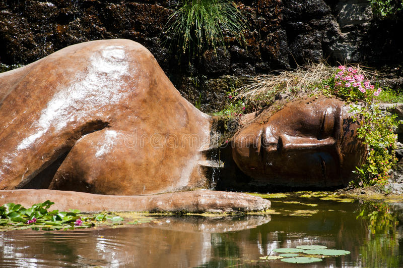 Statue of buddha in the water royalty free stock photos