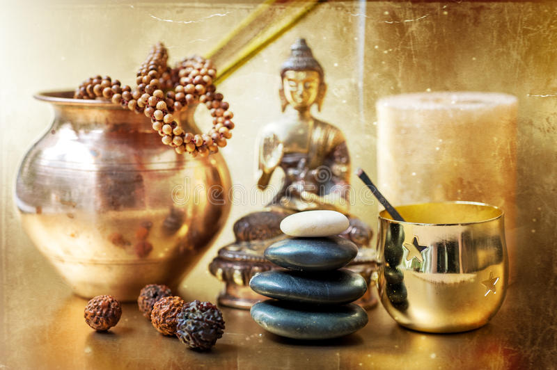 Statue of Buddha, zen stones, incense. stock image