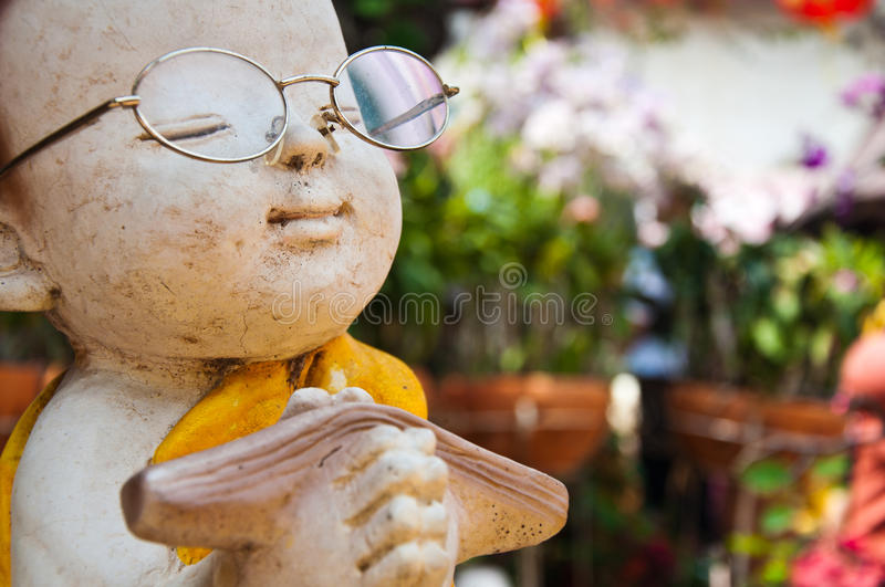 Download Statue of Buddhist novice stock image. Image of rock - 18495391