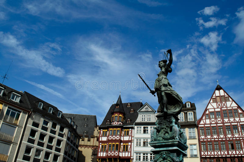 Statue and building at Romer Platz in Frankfurt royalty free stock photos