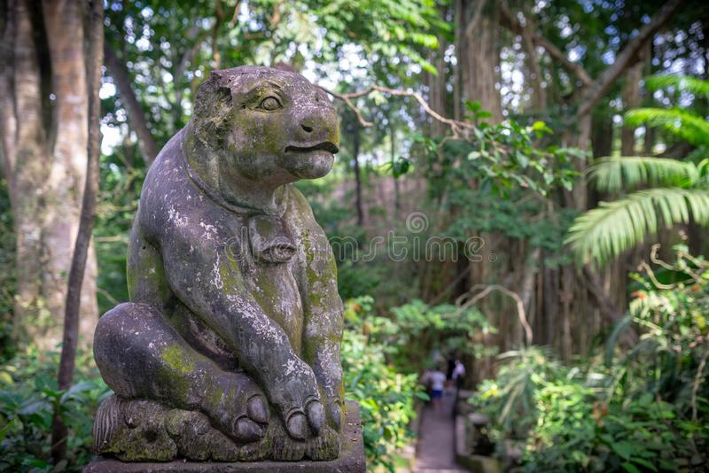 Statue of a calf, Monkey forest, Ubud, Bali, Indonesia. Statue of a calf, taken on an overcast afternoon, Monkey forest, Ubud, Bali, Indonesia royalty free stock image