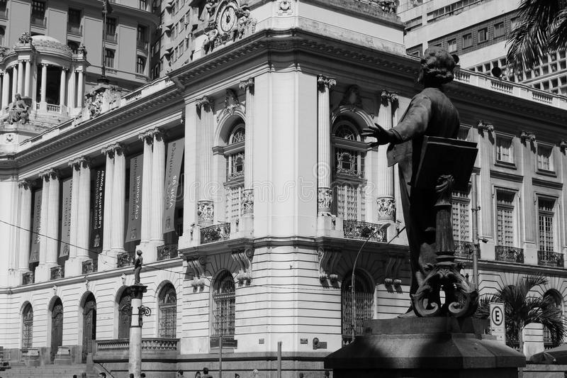 Statue of the Carlos Gomes mastery and Rio de Janeiro City hall on background. royalty free stock photos
