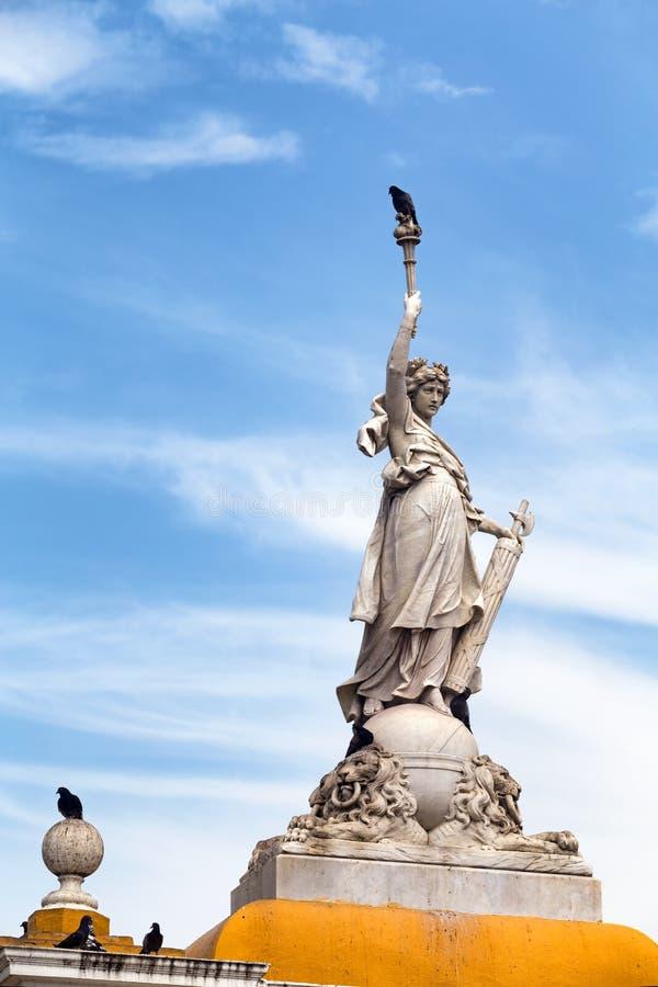Statue in Cartagena. Birds land on statue at the Parque Del Centenario in Cartagena, Colombia royalty free stock photography