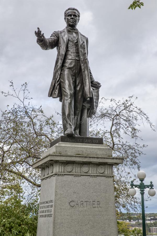 Statue of Cartier in Quebec City Canada. With cloudy background stock photography