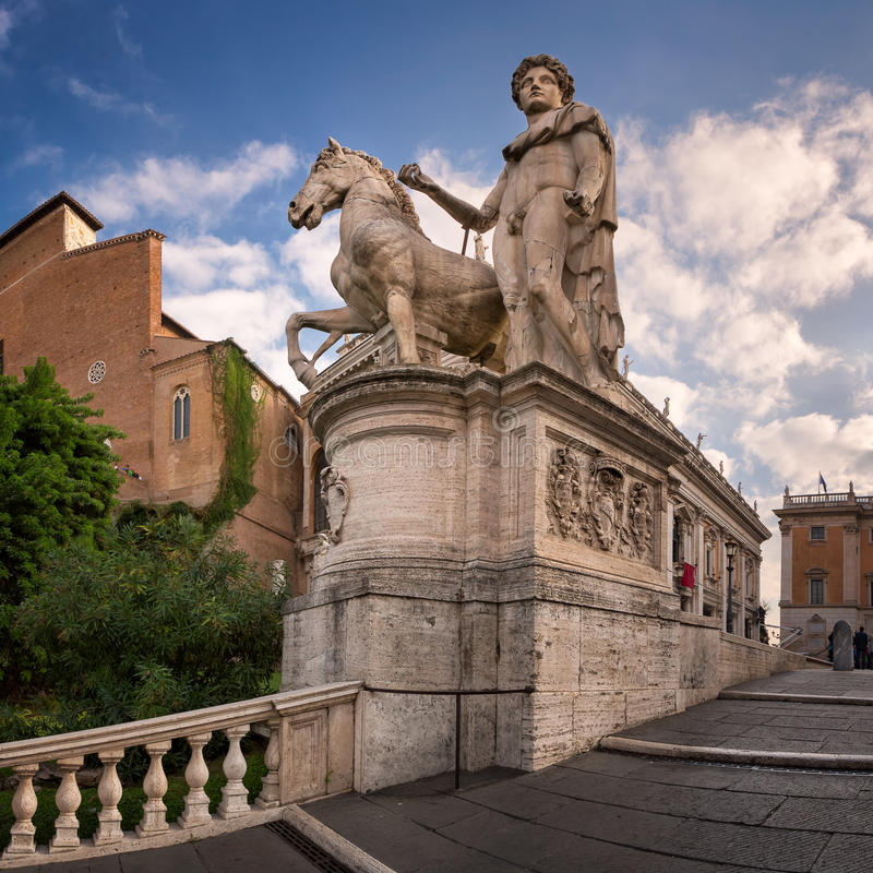 Statue of Castor at the Cordonata Stairs to the Piazza del Campidoglio Square at the Capitoline Hill, Rome, Italy stock image
