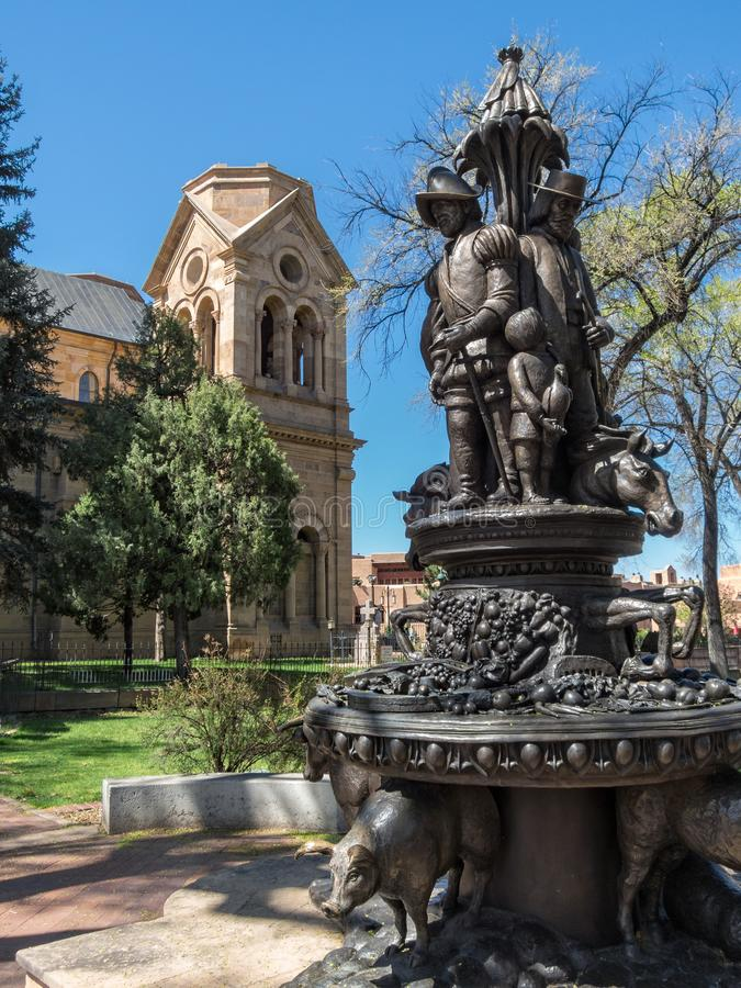 Statue in Cathedral Park in Santa Fe, New Mexico. A statue in Cathedral Park commemorates the Spanish settlers in Santa Fe, New Mexico stock photography