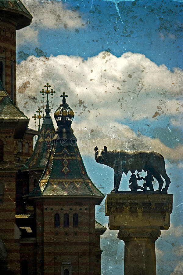Statue with cathedral, wolf, Remus and Romulus. Timisoara, Roman. Statue with cathedral, wolf, Remus and Romulus. Twoo symbols for Timisoara, Romania. Image royalty free stock photo
