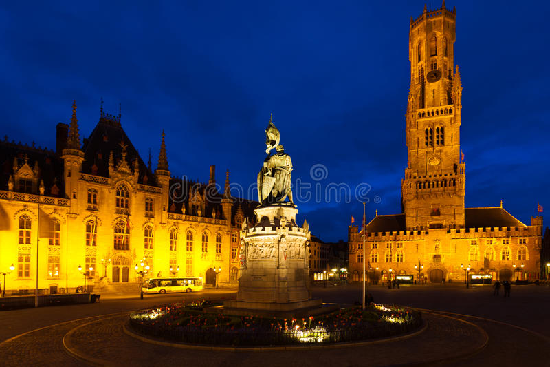Statue Center Old City Square Bruges Belfry. The city center square, statue and historic belfry in the medieval old town of Bruges (Brugge), Belgium at blue hour stock photography