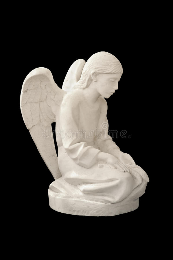 Statue of child angel. Isolated on black royalty free stock photos