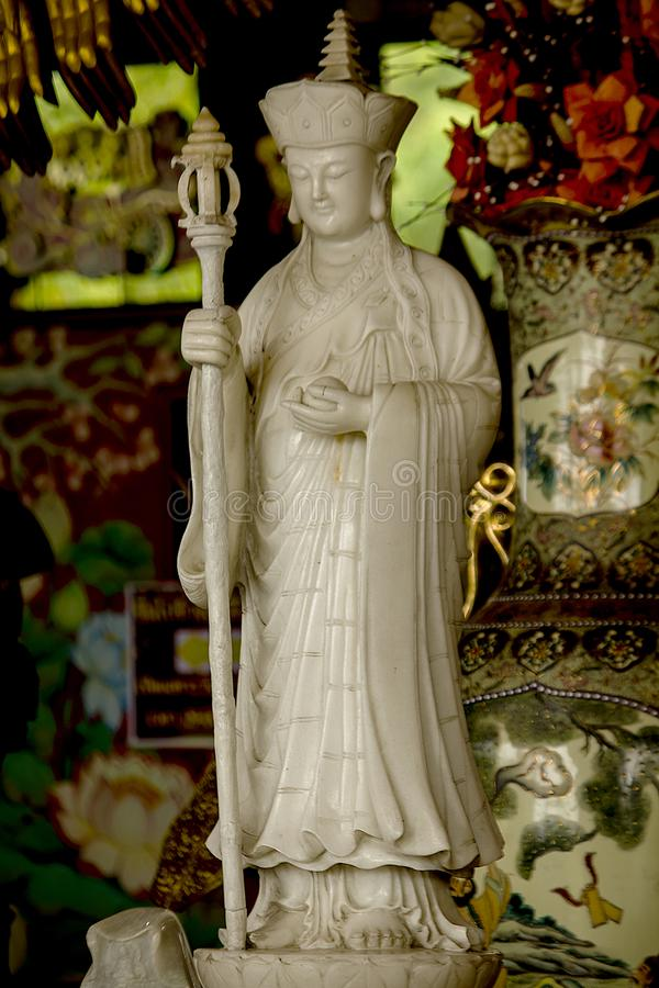 Statue of a Chinese priest Carved from white marble. Chinese monks, carved from white marble, are unique in China stock photo