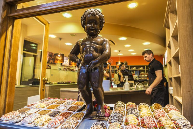 Statue of chocolate of Manneken pis in Brussels, Belgium. Brussels, Belgium - August 26, 2017: Statue of chocolate of Manneken pis as a candy store decoration royalty free stock photos