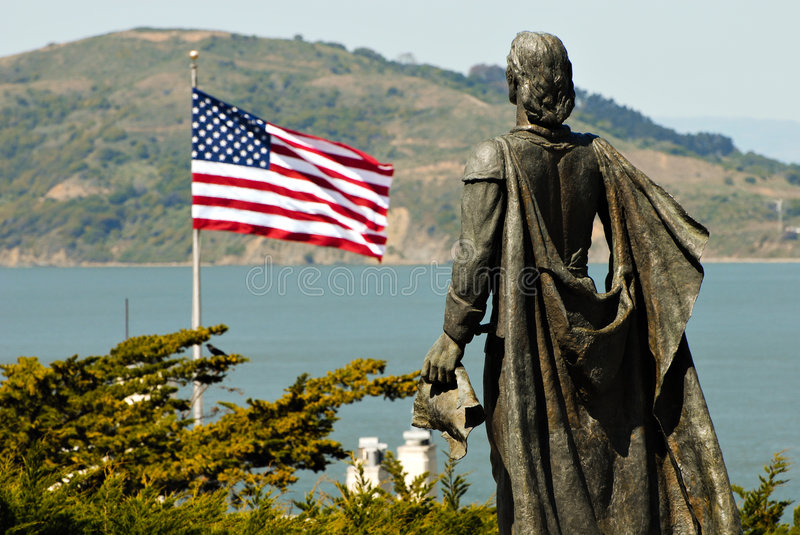 Statue of Christopher Columbus and USA flag stock images