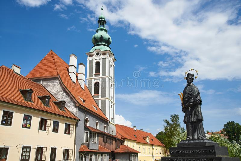 Statue and Church, Cesky Krumlov stock photo