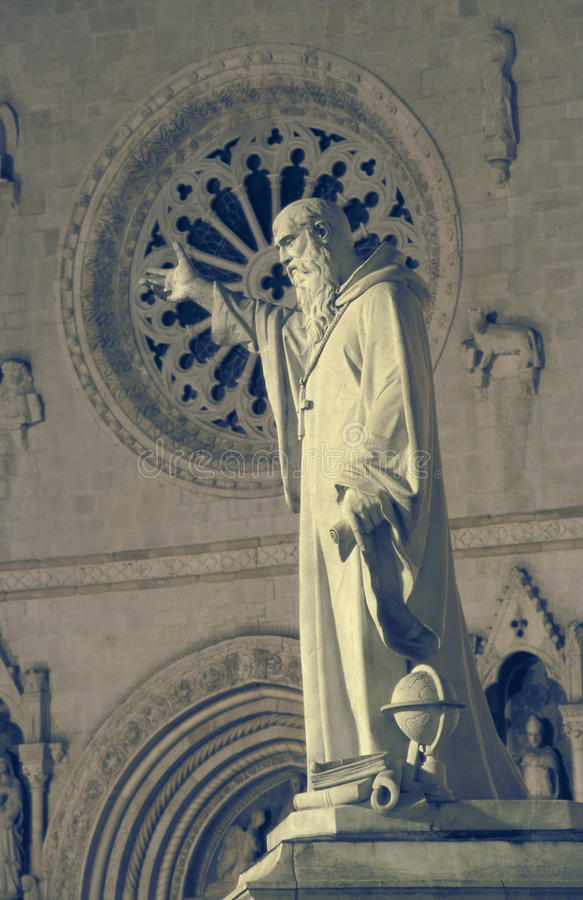 The statue and the church of St. Benedict in Norcia, Umbria, Italy stock photos