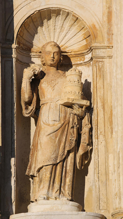 Statue at Coimbra University, Portugal. Statue representing Theology at the Palace Gate or Iron Gate in the University of Coimbra, Portugal stock images
