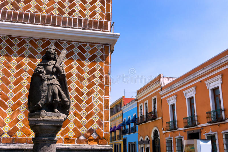 Statue with Colonial Houses in Puebla. Statue with colonial houses in street in downtown Puebla, Mexico stock photo
