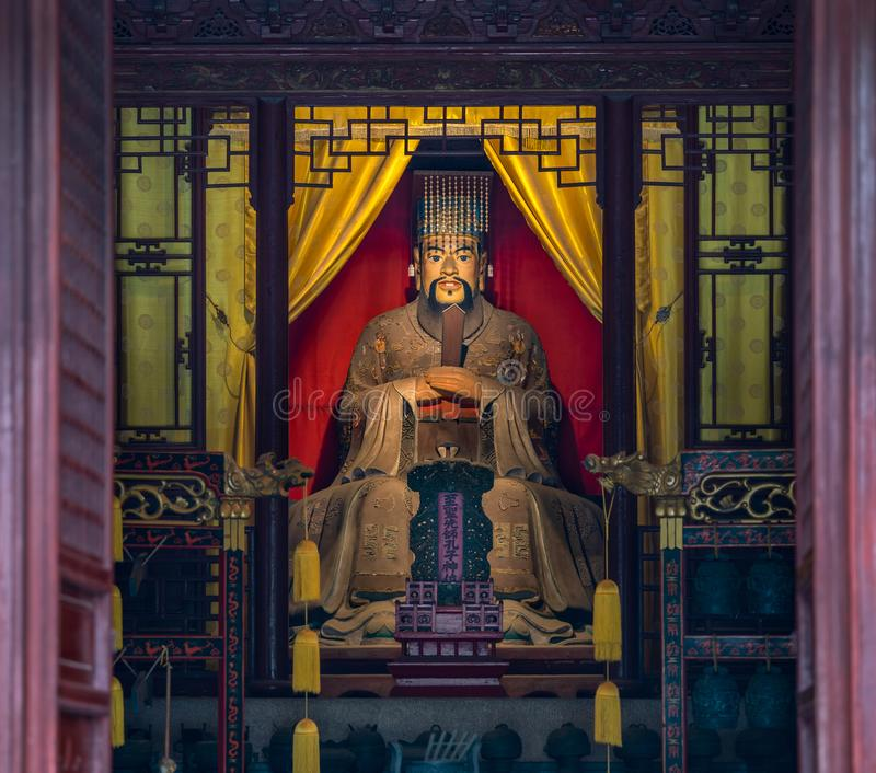 Statue of Confucius or Kongzi in Confucian Temple or Kongmiao at Jiading, Shanghai, China. Built initially in 13th century stock photography