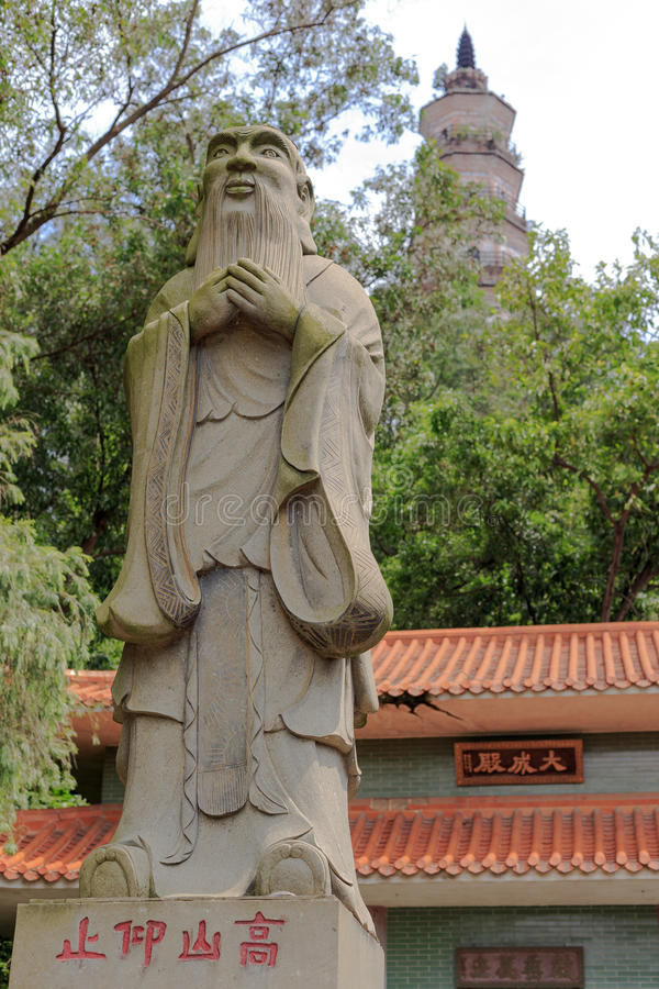 Statue of Confucius. Shunde, Guangdong, China - May 27, 2015: Statue and tower of Confucius in Shun Feng Shan Park in Shunde China royalty free stock image