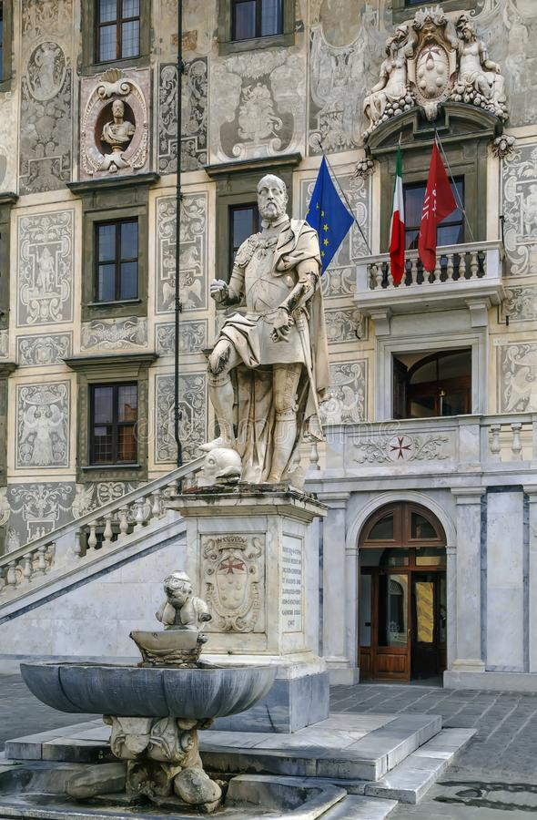Statue of Cosimo I, Pisa, Italy. The statue of Cosimo I de Medici stands in the middle of Knights` Square of Pisa, just in front of Palazzo della Carovana royalty free stock images