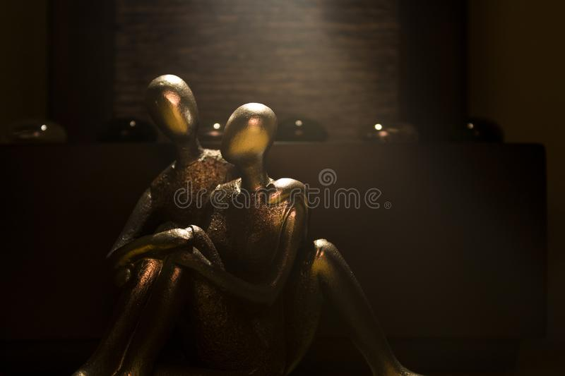 Statue couple under a light stock images