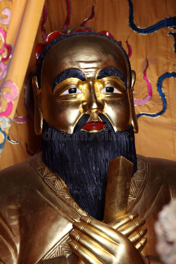 Statue d'or de Confucius photo stock