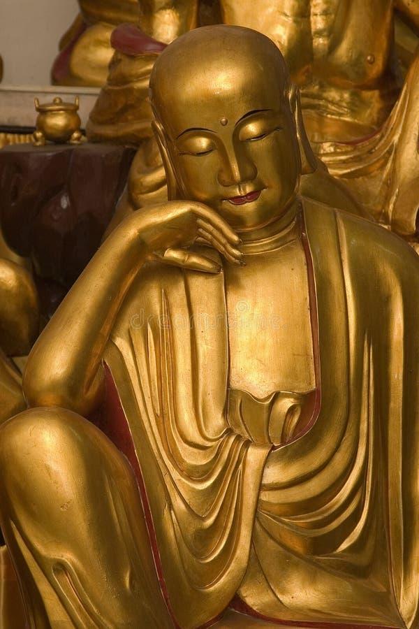 Statue d'or de Lohan image libre de droits