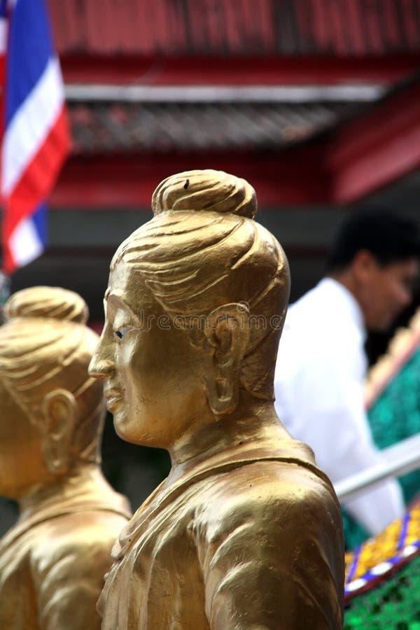 Statue d'or de moine photos stock