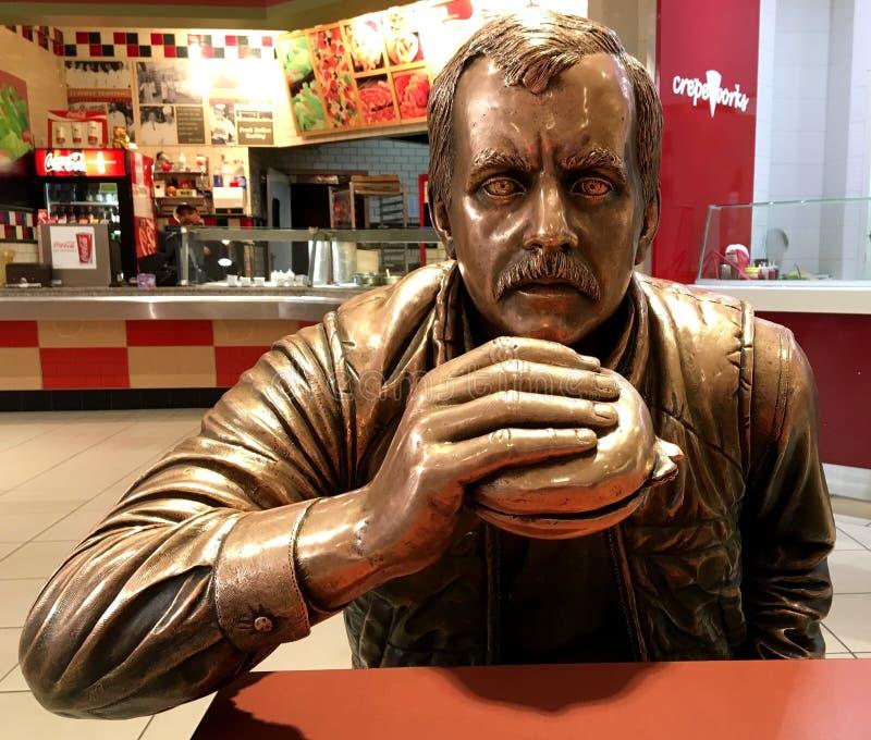 Statue d'un homme avec un repas images stock