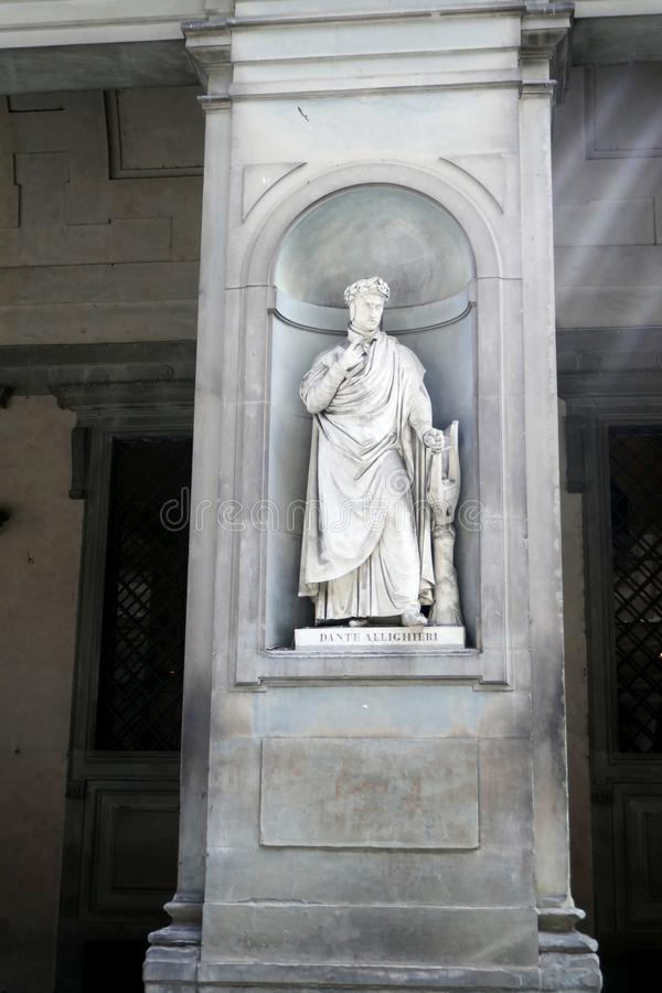 Statue of DANTE  ALLIGHIERI  in the niches of the Uffizi Gallery colonnade. Florence royalty free stock photos