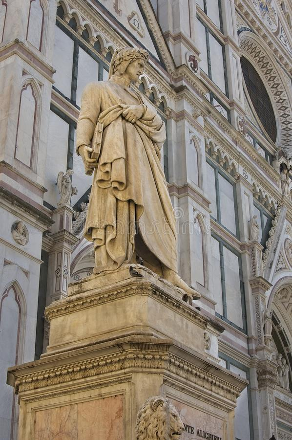 Statue of Dante in Florence. This statue of Dante is set against the ornate cathedral in Florence Italy stock images