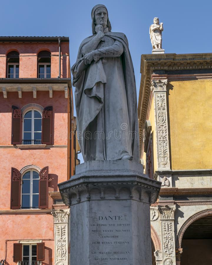 Statue of Dante in Verona. The famous old statue of Dante Aligheri in the city of Verona, Italy on a warm summer day with blue skies royalty free stock photo