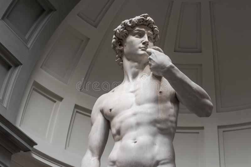 The statue of David is a bottom view without tourists stock photos