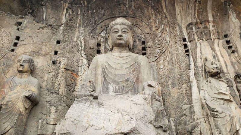 Statue de Bouddha de pierre dans des grottes de Longmen, Luoyang photographie stock libre de droits