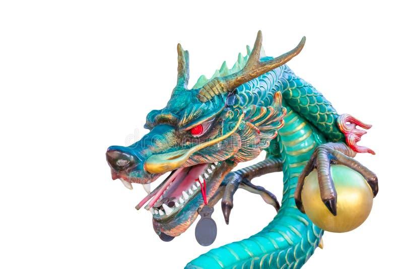 Statue de dragon vert d'isolement sur le fond blanc photographie stock