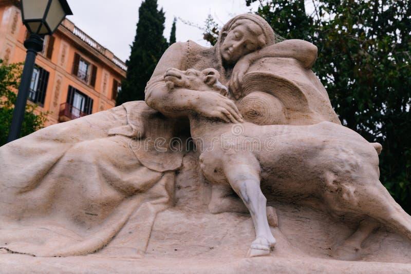 Statue de femme et de chèvre de sommeil photo stock