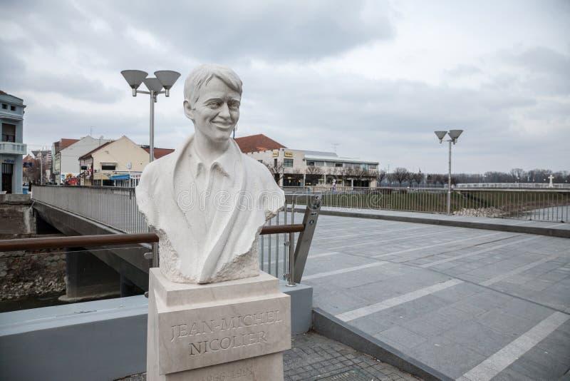 Statue de Jean Michel Nicolier dans la ville déchirée par guerre de Vukovar, près du pont de Nicolier photo libre de droits