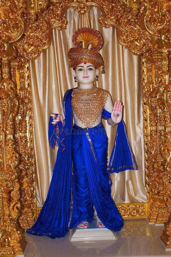 Statue de Shri Dhanshyam Maharaj, mandir Katraj de Swaminarayan de BAPS images libres de droits