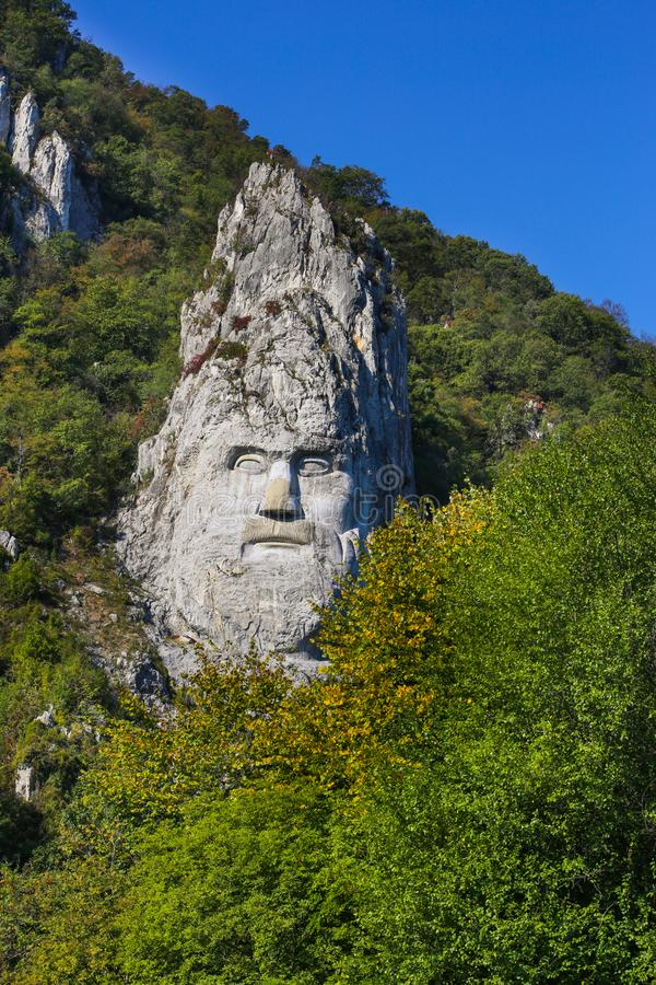 The statue of Decebal carved in the mountain. Decebal`s head carved in rock, Iron Gates Natural Park stock photos